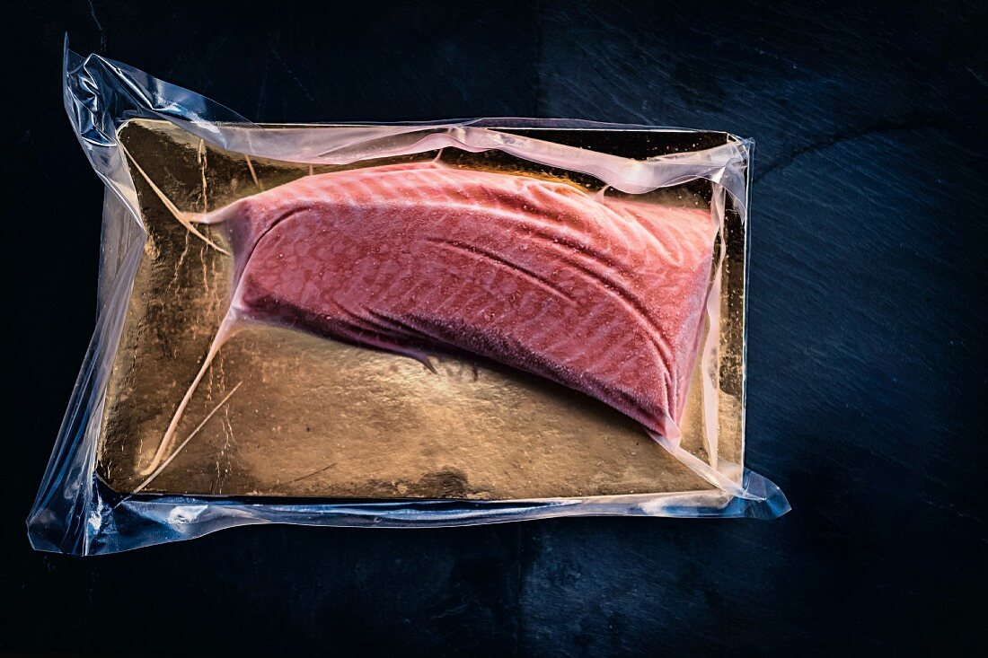 Online fish supplier: shock-frosted loin fillet of salmon in its packaging