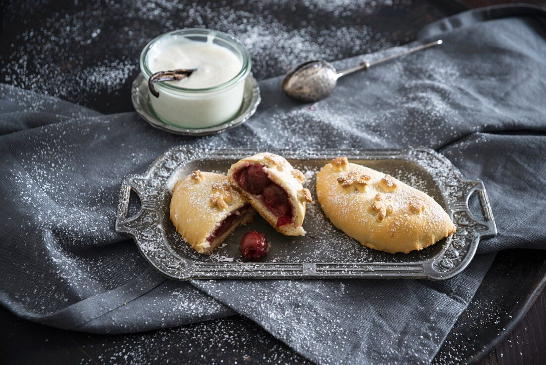 A vegan yeast pastry filled with sour cherries and vanilla sauce