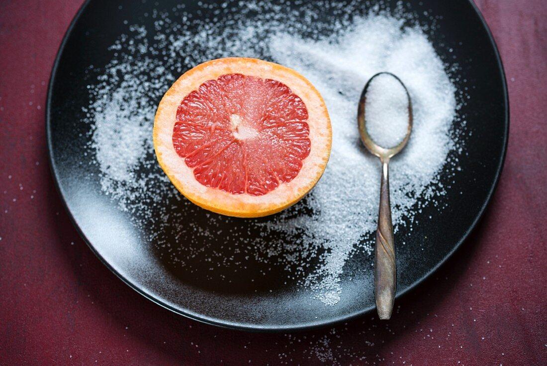 Pink grapefruit with sugar