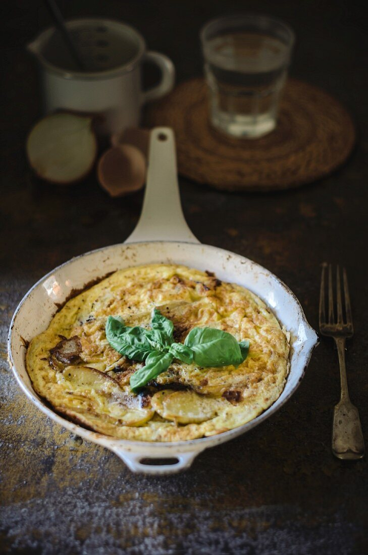 Spanish omelette with potatoes in a pan