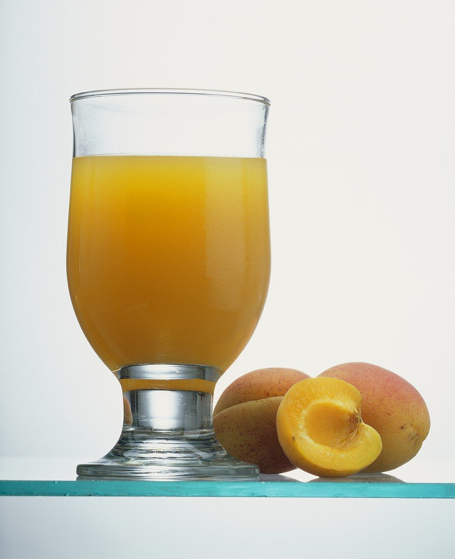 A Glass of Peach Juice with Fresh Peaches