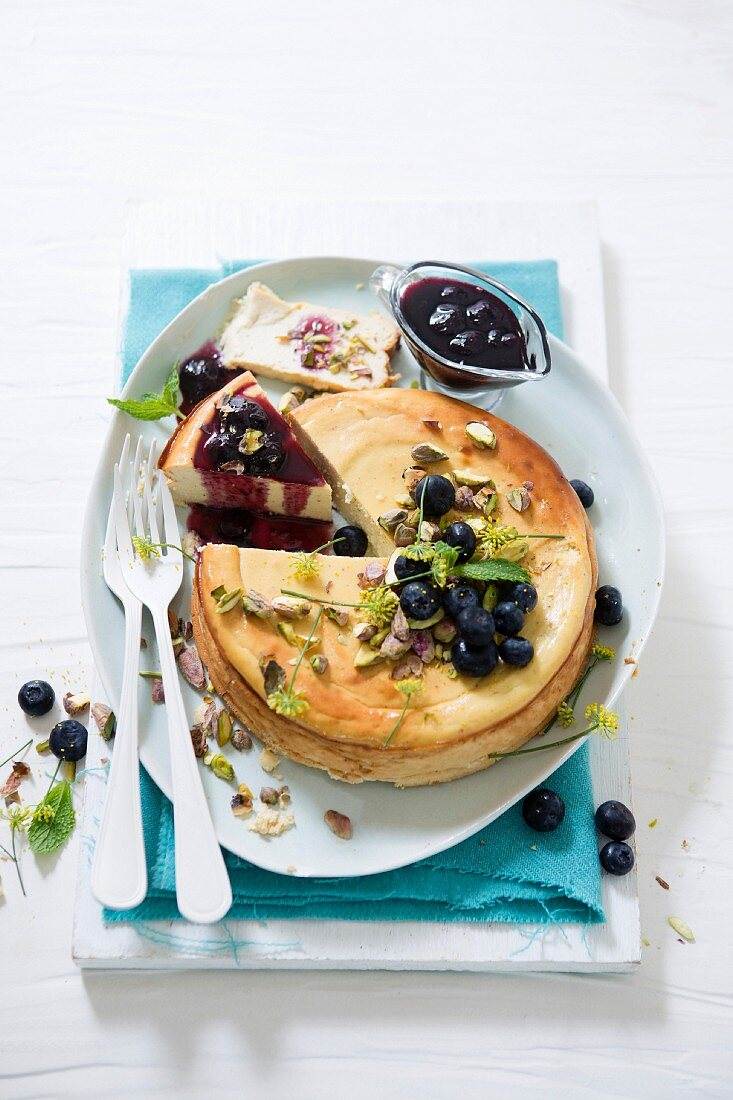 Baked ricotta, honey and yoghurt tart with blueberry and balsamic sauce