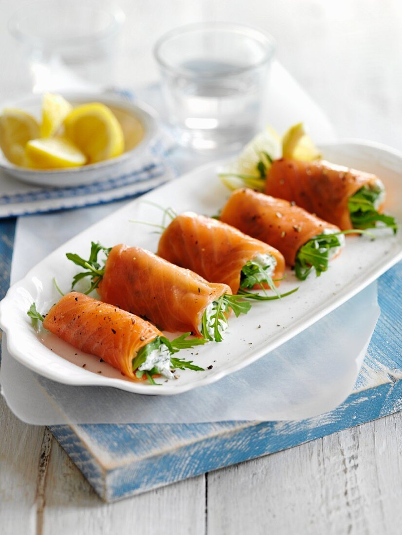 Smoked salmon rolls with cream cheese and rocket