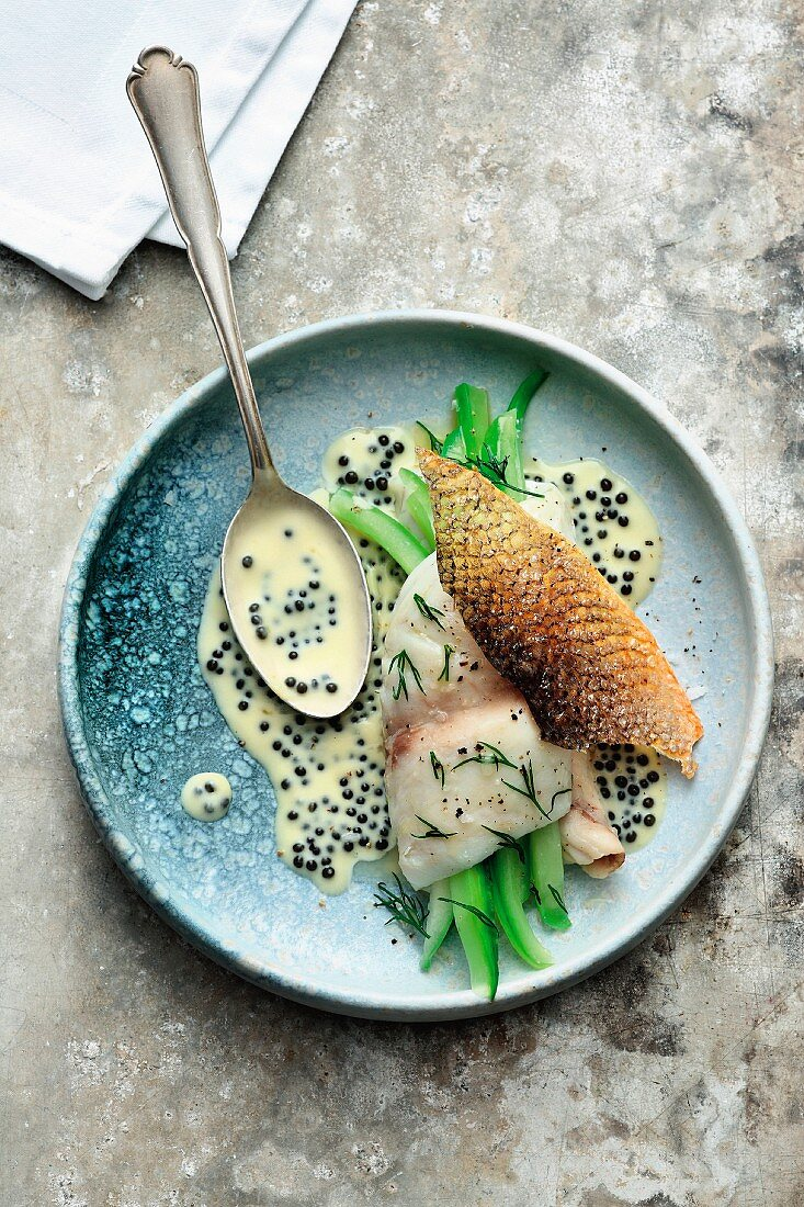 Steamed sea bass with cucumber and caviar nage