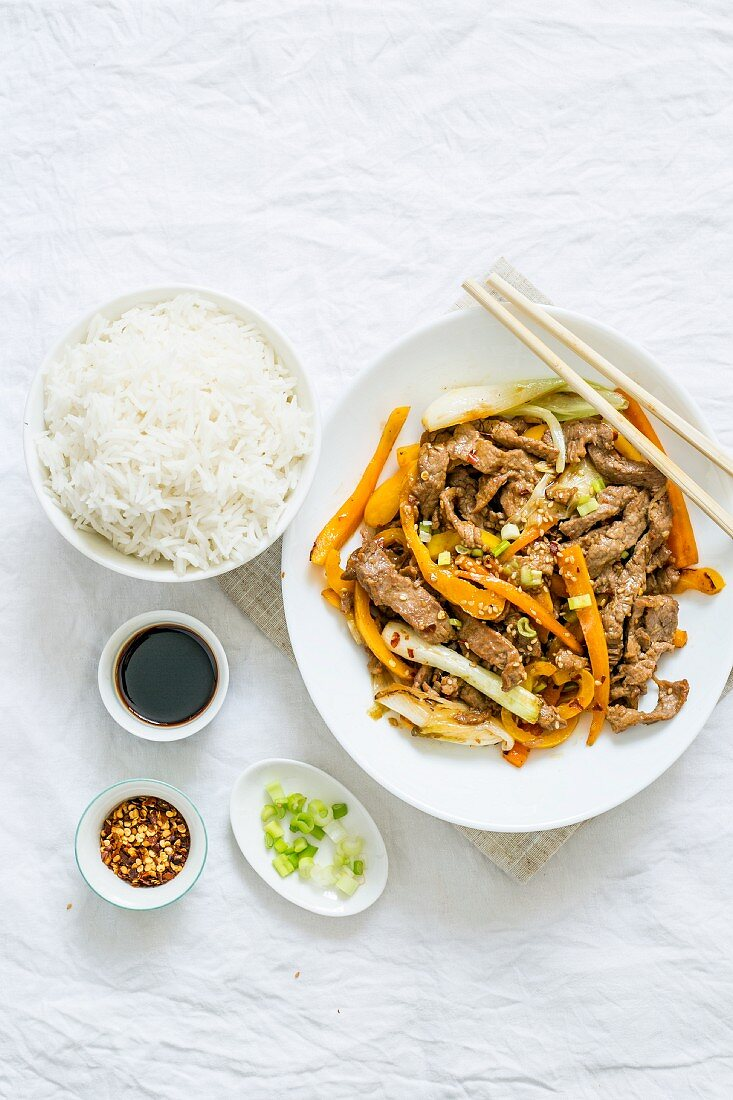 Beef stir fry with carrot and spring onion served with rice (China)