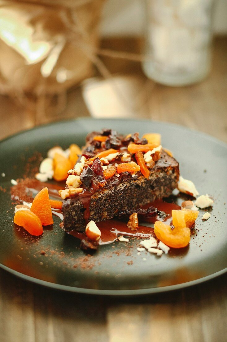 A slice of poppy seed tart with nuts and candied fruits