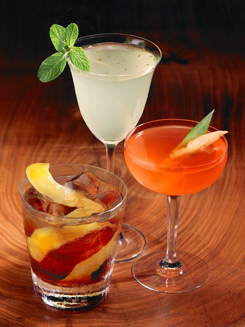Three cocktails: Daiquiri, Cosmopolitan and Old Fashioned