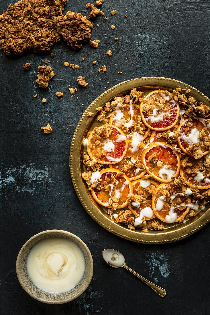 Crunchy muesli with blood orange slices and yoghurt (seen from above)
