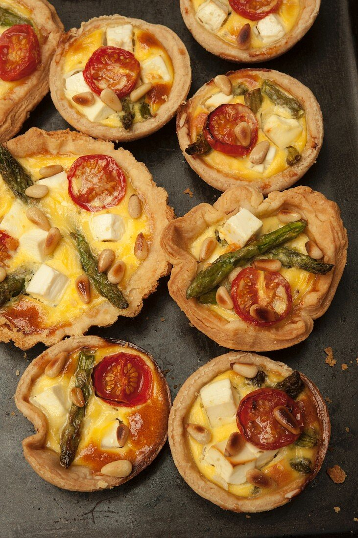 Asparagus, tomato, feta and pine nut tarts (seen from above)
