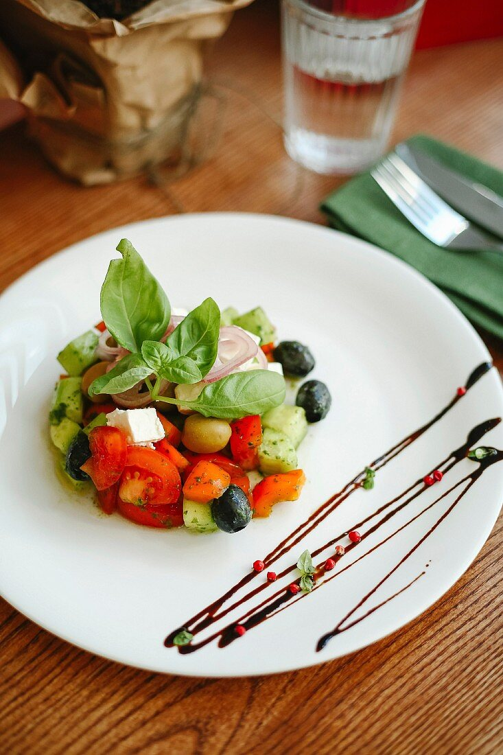 Greek salad with cucumber, tomatoes, olives and fete