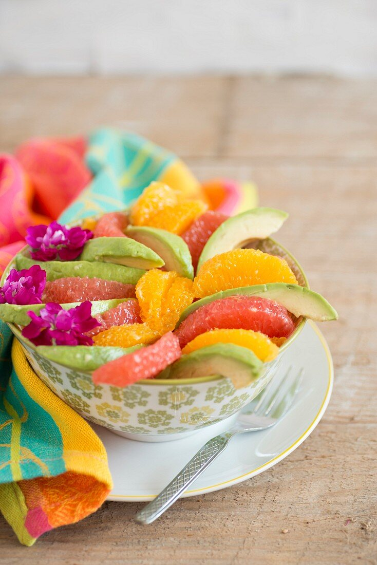 Avocado salad with orange and pink grapefruit wedges