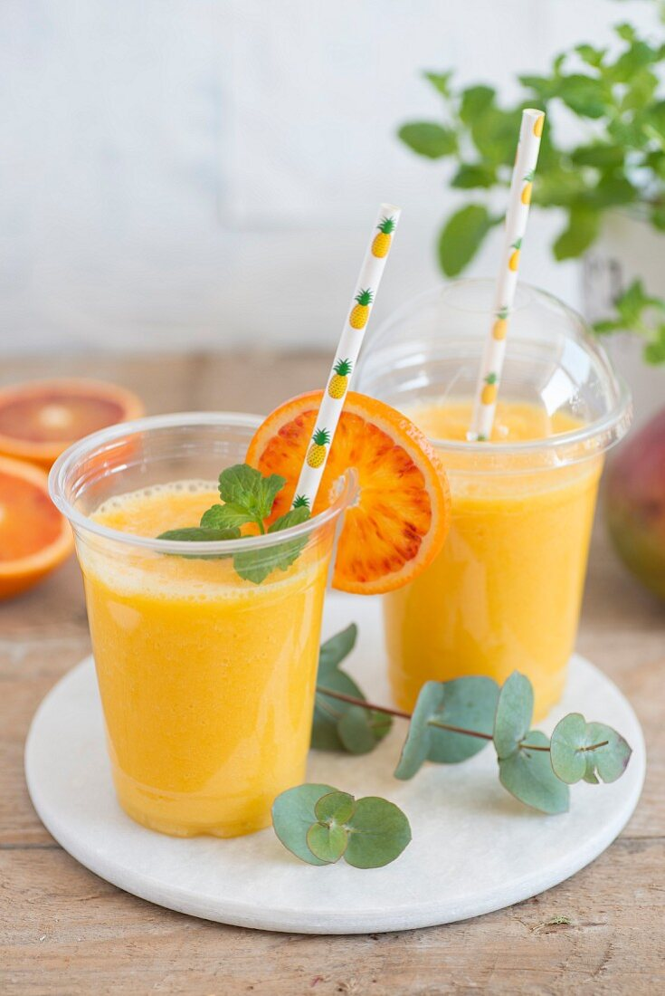 Pineapple, mango and orange juice in to-go cups