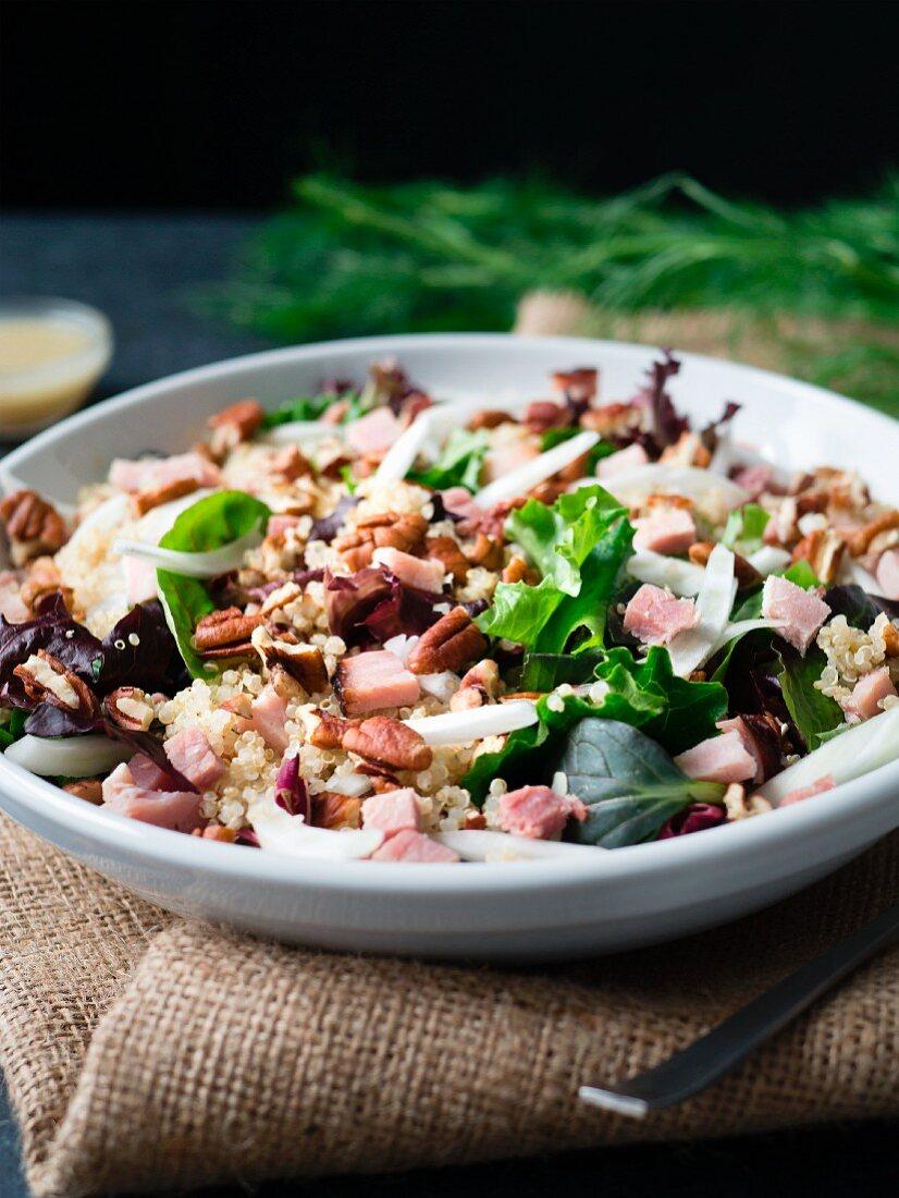 Ham, fennel and quinoa salad on burlap
