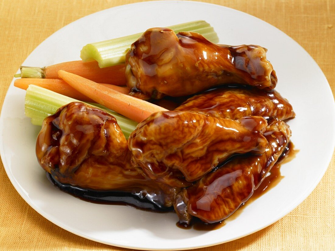 Glazed chicken legs with carrots and celery (Asia)