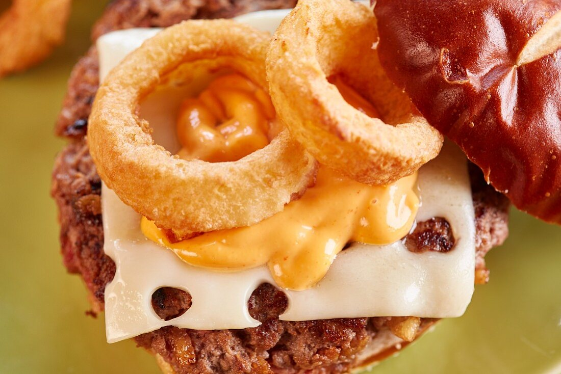 Teriyaki burger with emmental and onion rings
