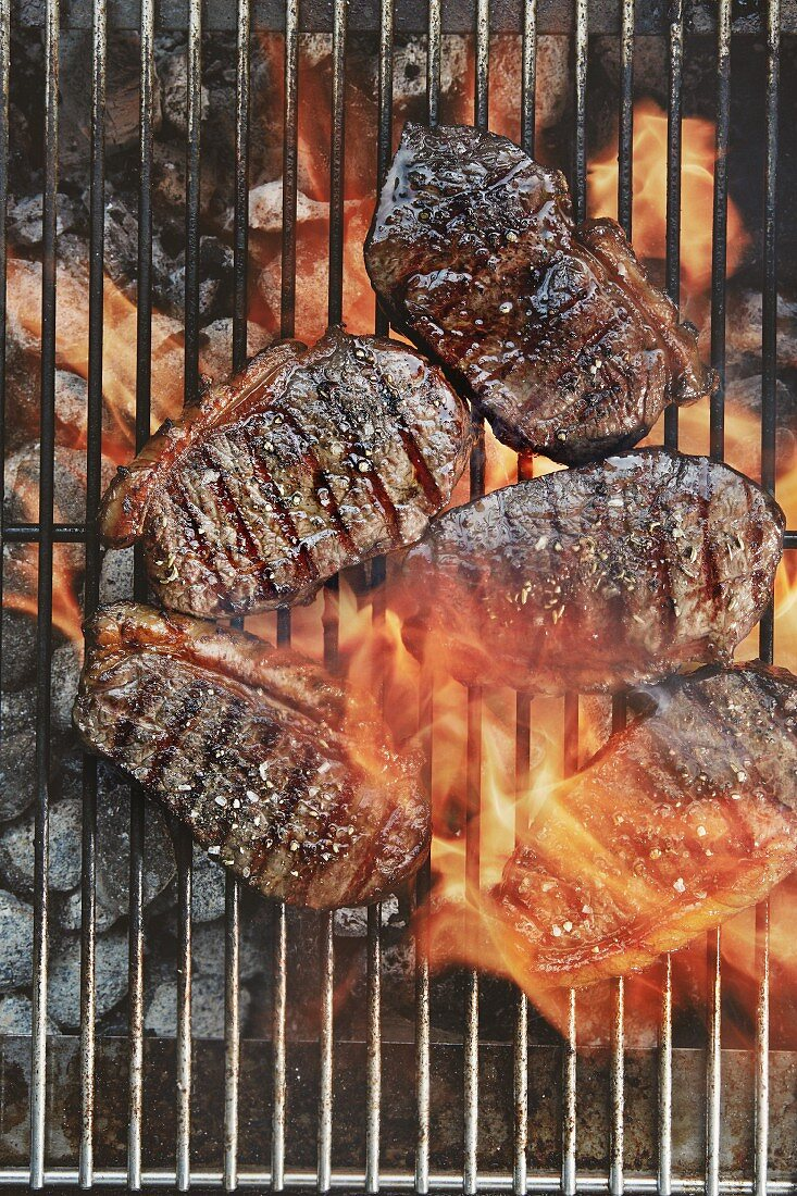 Sirloin steaks on a grill (top view)