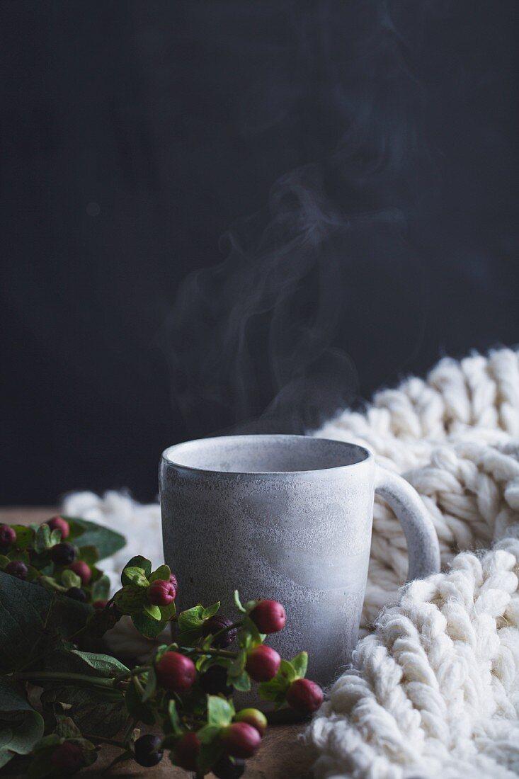A hot drink in a stoneware mug