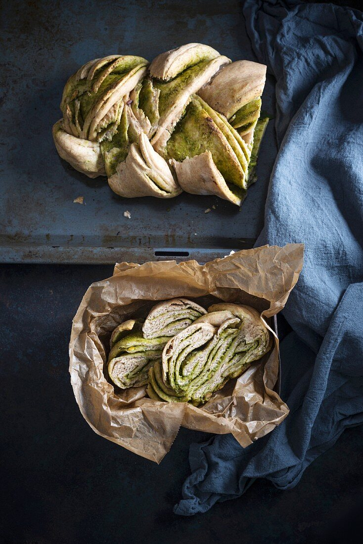Vegan braided yeast bread filled with green pesto