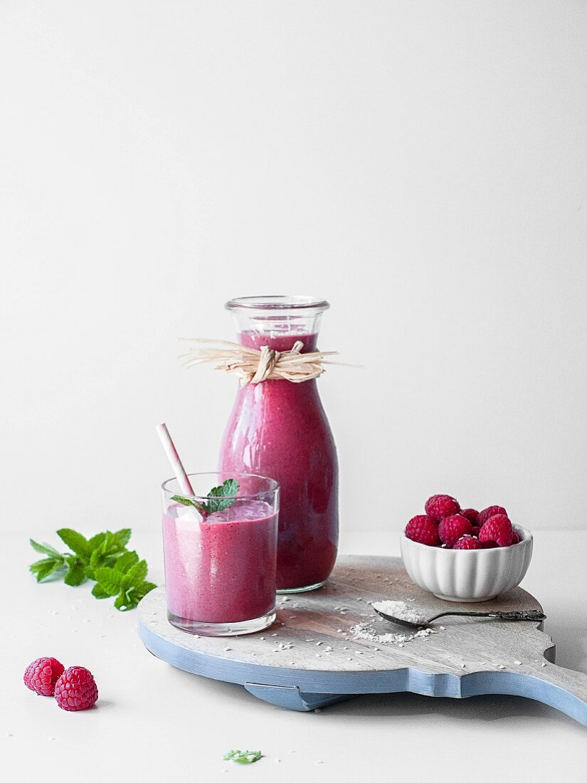 Pink liquorice and raspberry smoothie served in a glass and carafe