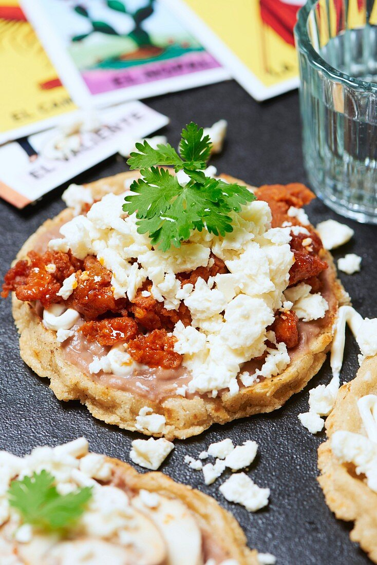 Sope, a traditional Mexican dish with bean purée, chorizo, cheese, sour cream and coriander