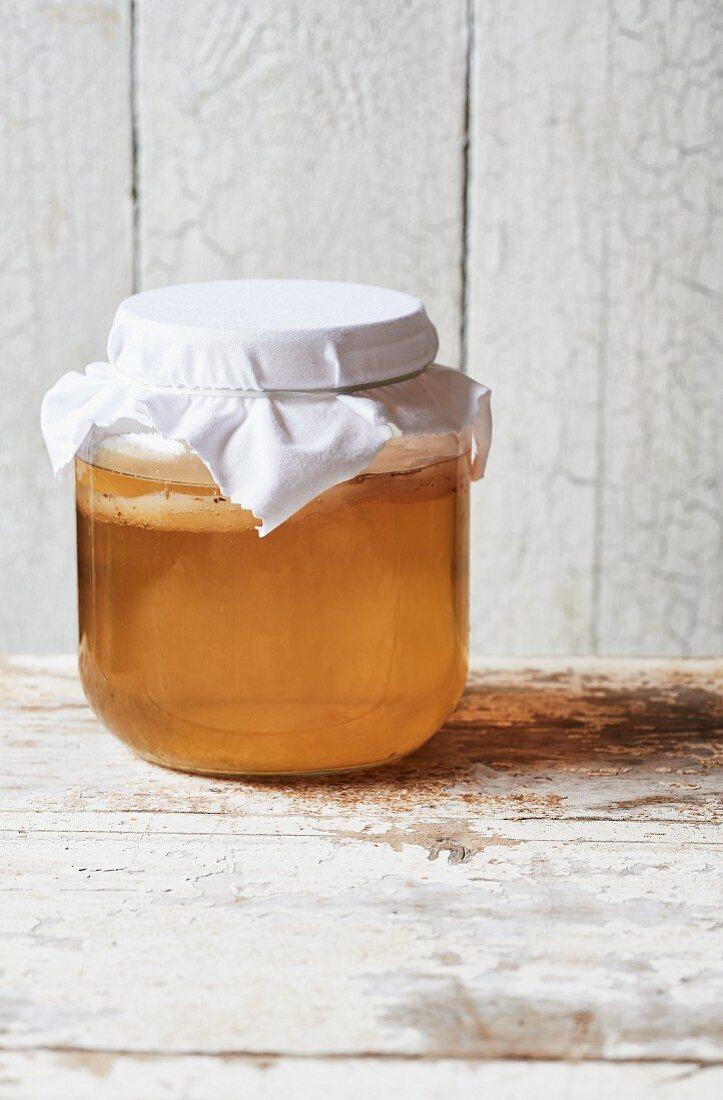Homemade Kombucha tea in a sealed jar