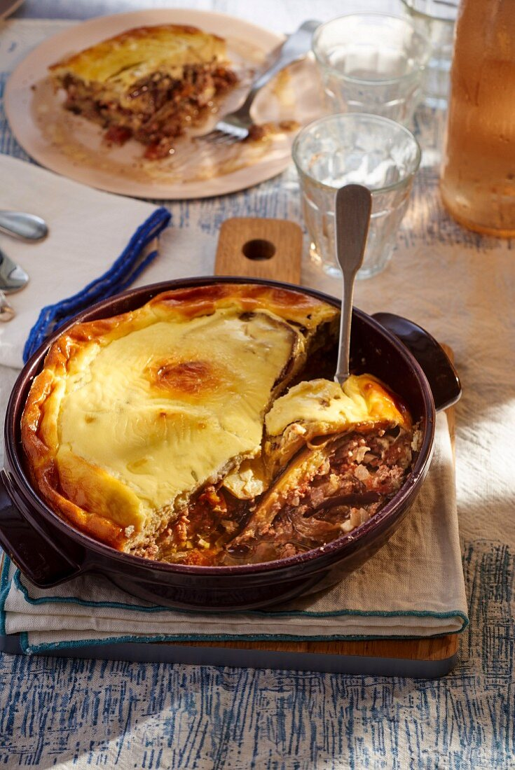 Moussaka in a round casserole dish
