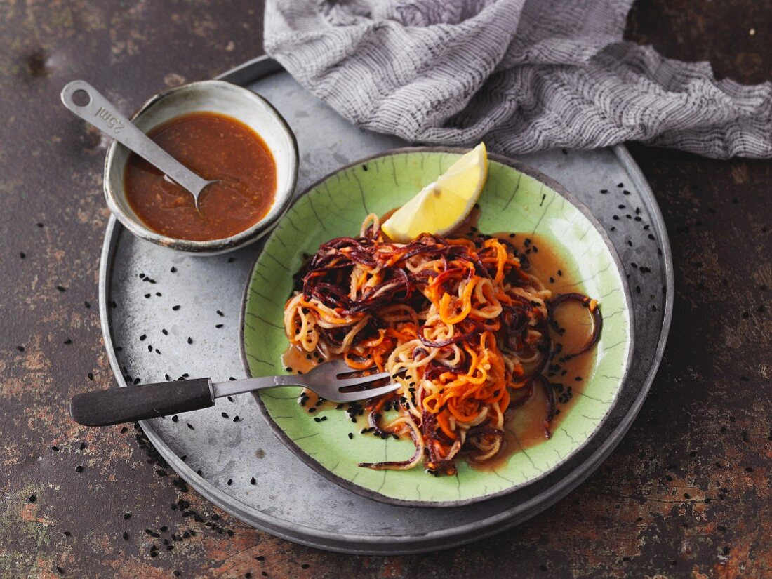 Brightly coloured carrot noodle salad with tahini