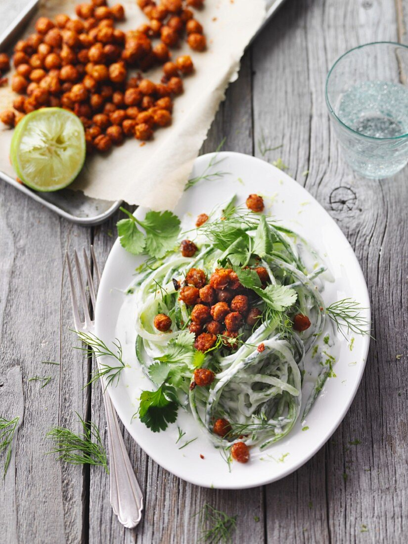 Vegetarian cucumber noodle salad with baked chickpeas