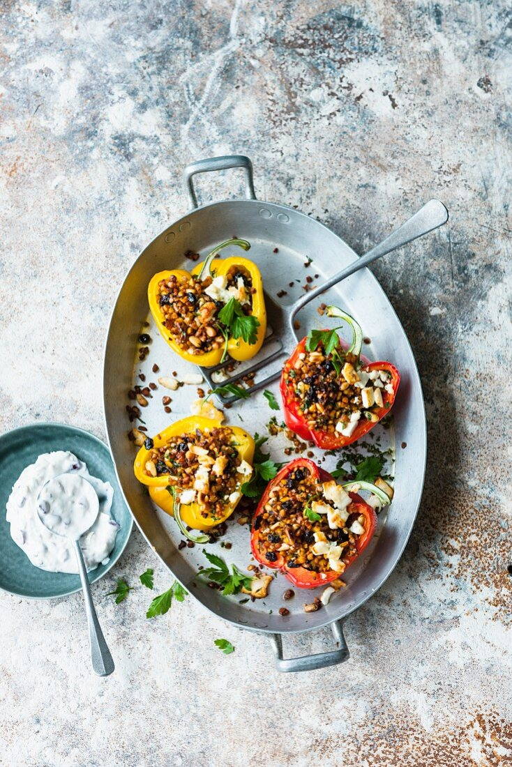 Stuffed peppers with lupin groats and soya and almond sauce