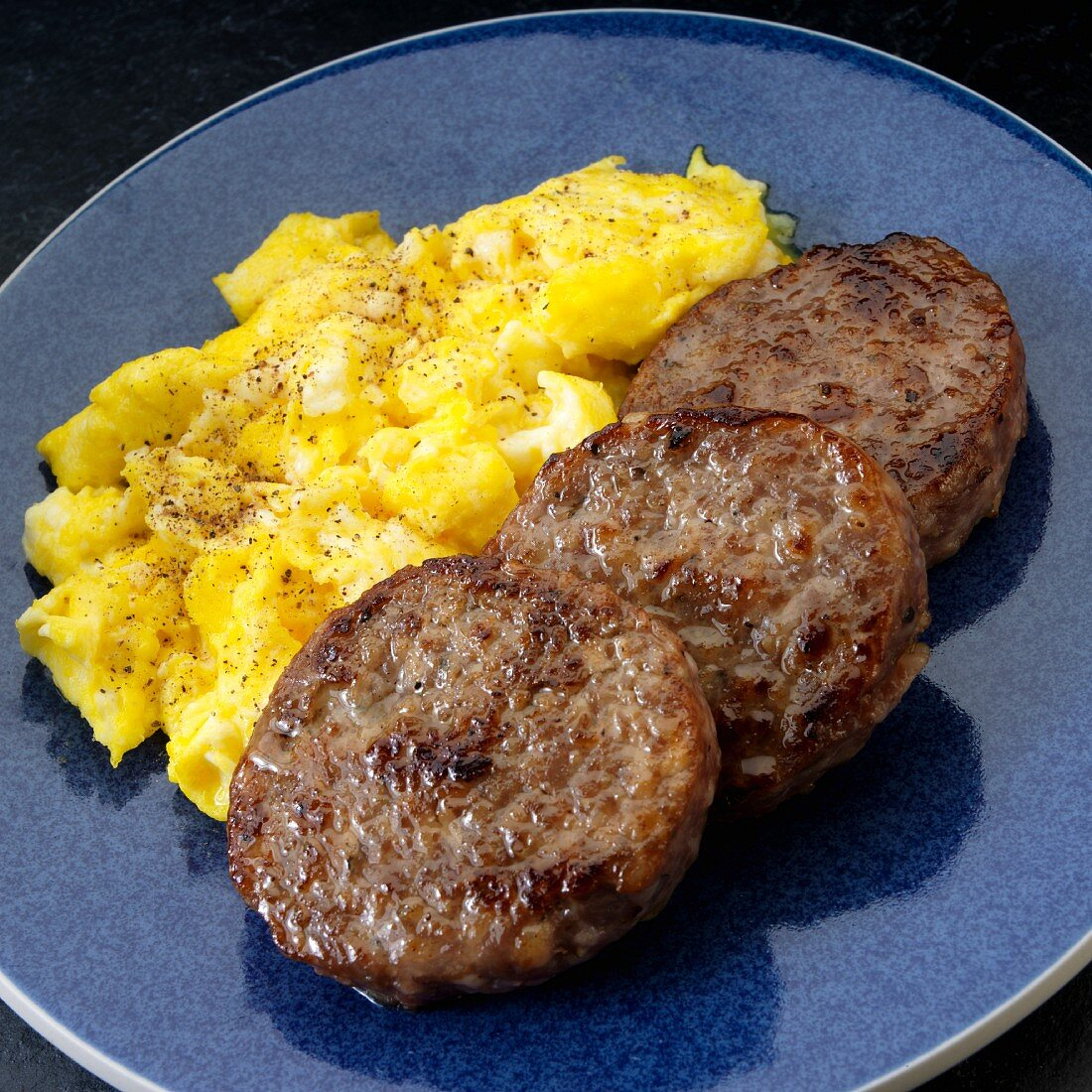 Pork sausage patties with scrambled eggs