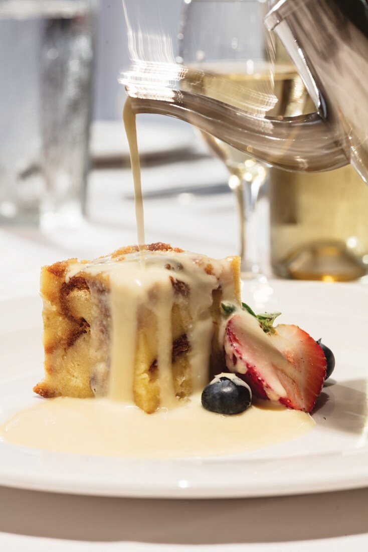 White bread pudding with raisins and rum creme anglaise