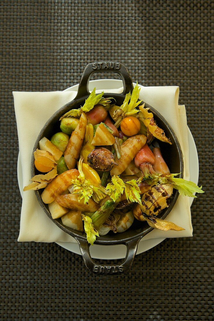 Roasted root vegetables in a cast iron pan (top view)