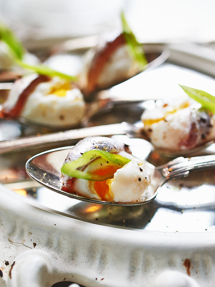Poached quail eggs with anchovies for New Year's Eve