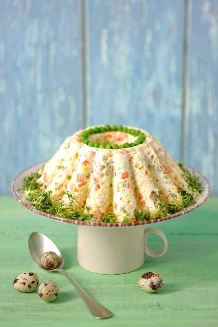 Vegetable salad with mayonnaise, decorated like a cake