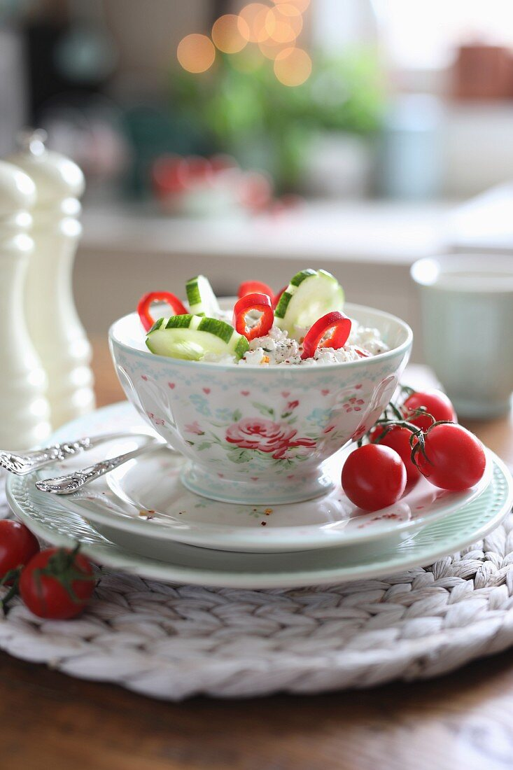 Cottage cheese with cucumbers, cherry tomatoes and peppers