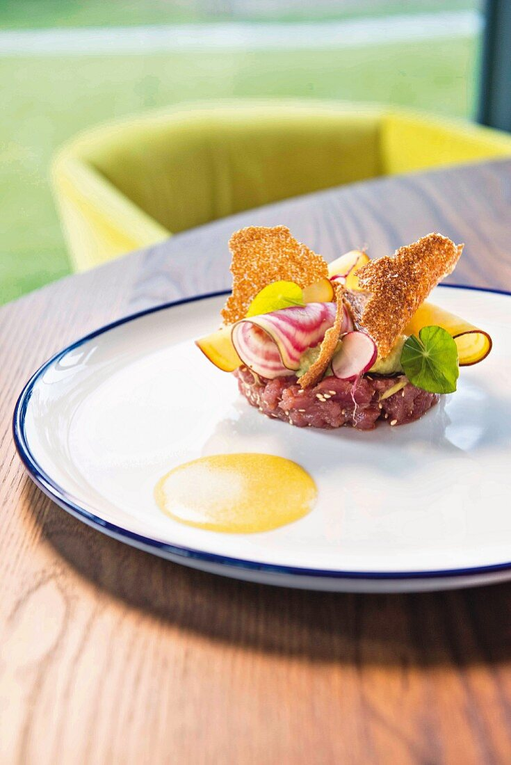 Tuna tartare with avocado, amaranth, radishes, soya and lemon oil from the Brix 0.1 restaurant in Brixen, South Tyrol, Italy