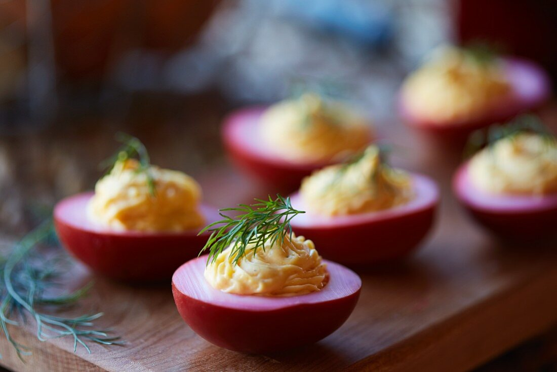 Stuffed eggs pickled in beetroot