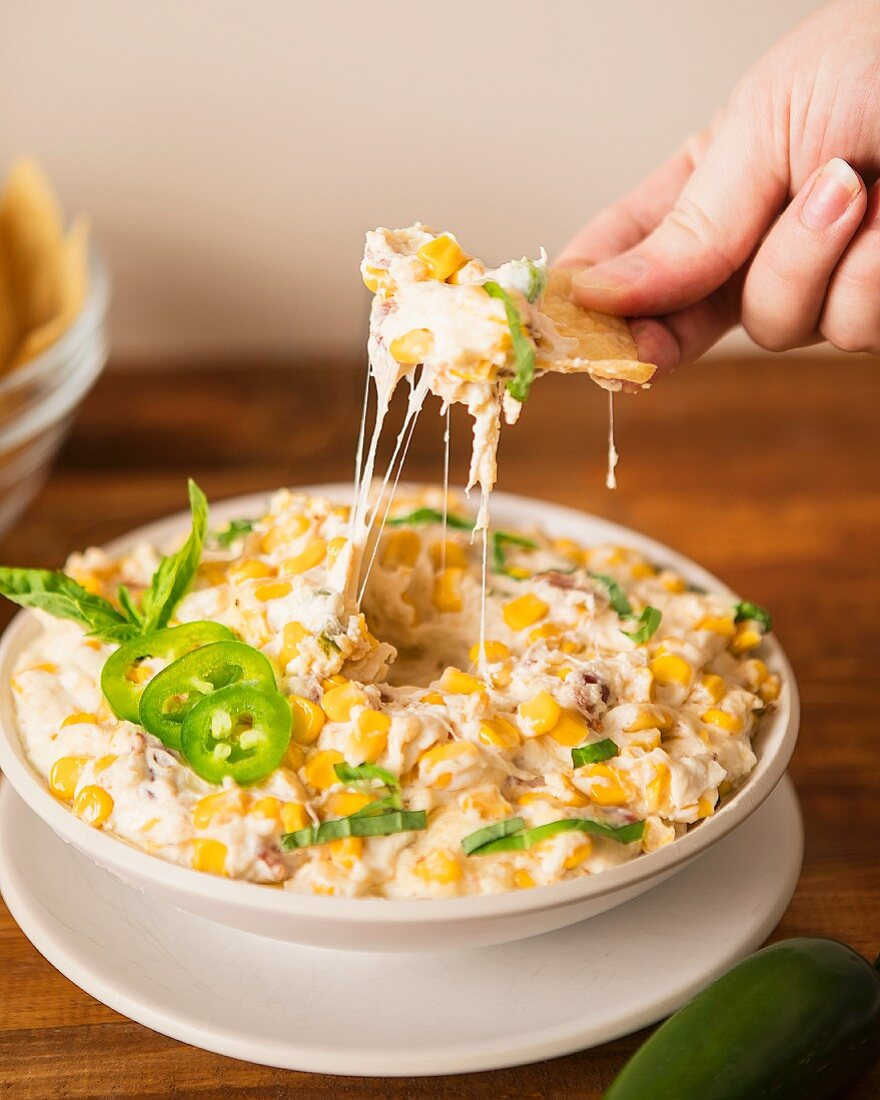 A cheese dip with corn, bacon and jalapenos (USA)