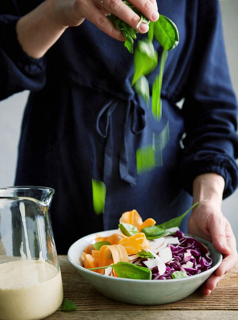 Veggie raw salad bowl with coconut flesh