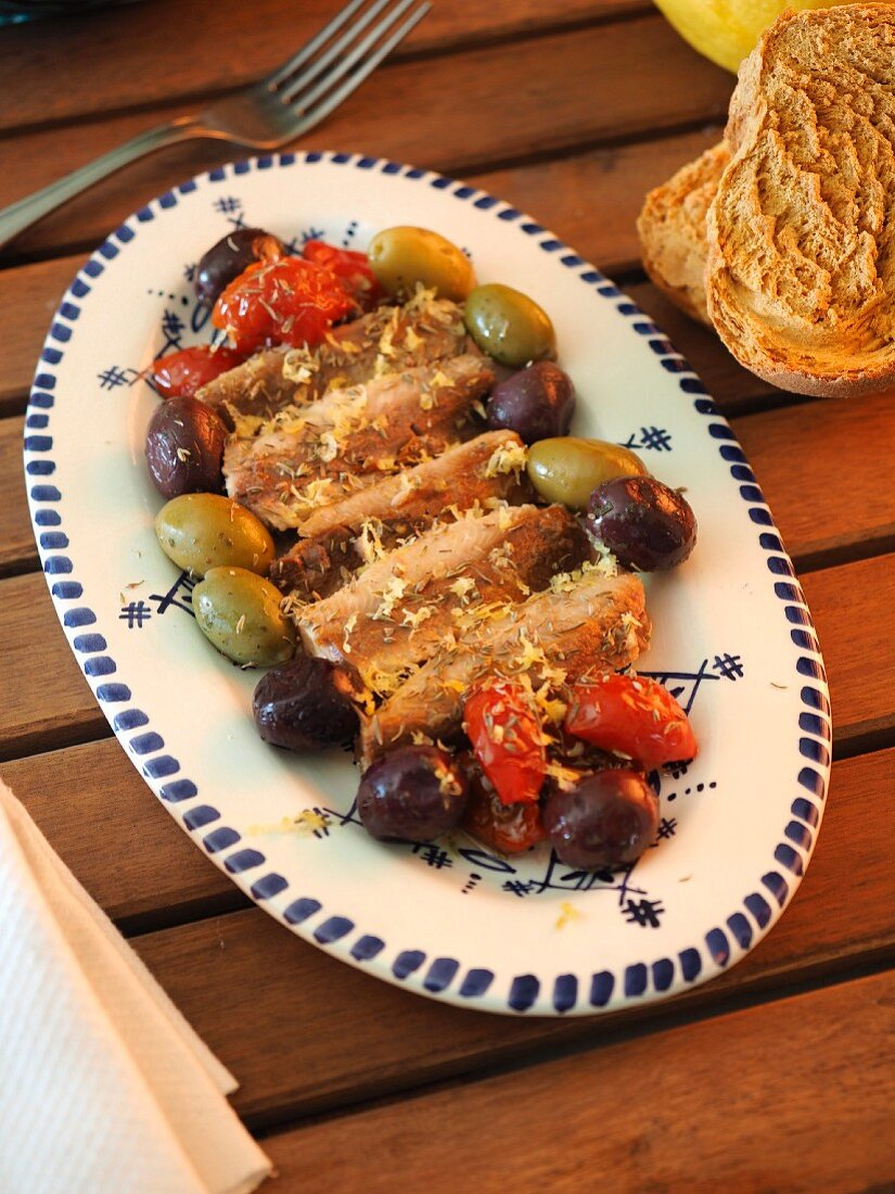 Canned sardines in olive oil with sicilian olives, dried Pachino cherry tomatoes, thyme and lemon zest, Italy