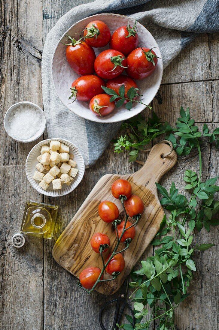 Fresh tomatoes on a vine on a chopping board