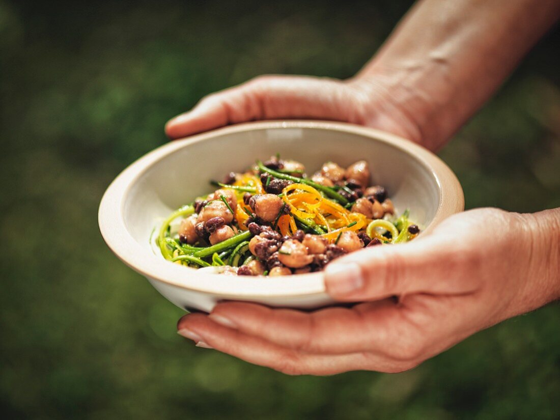 Chickpeas and beans with orange zest and zucchini