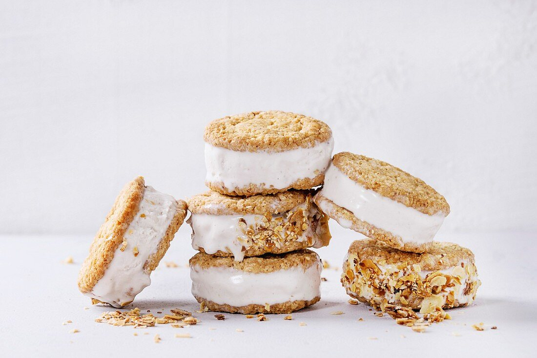 Set of homemade ice cream sandwiches in oat cookies with almond sugar crumbs