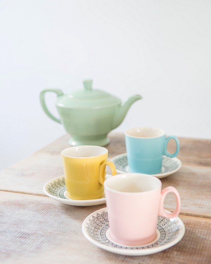 Pastel retro tea set on rustic wooden table