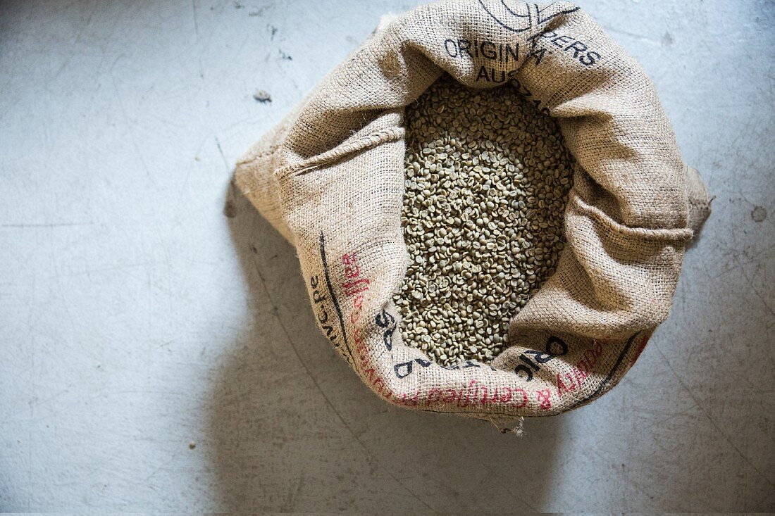 Unroasted coffee beans in a jute sack