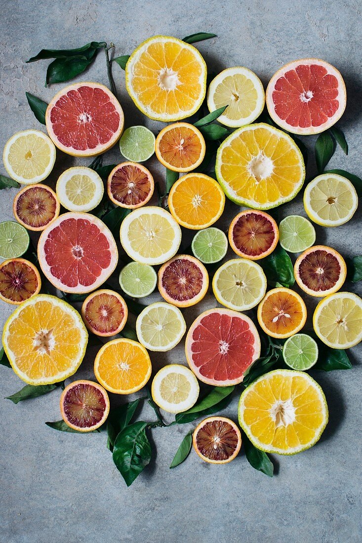 Various halved citrus fruits