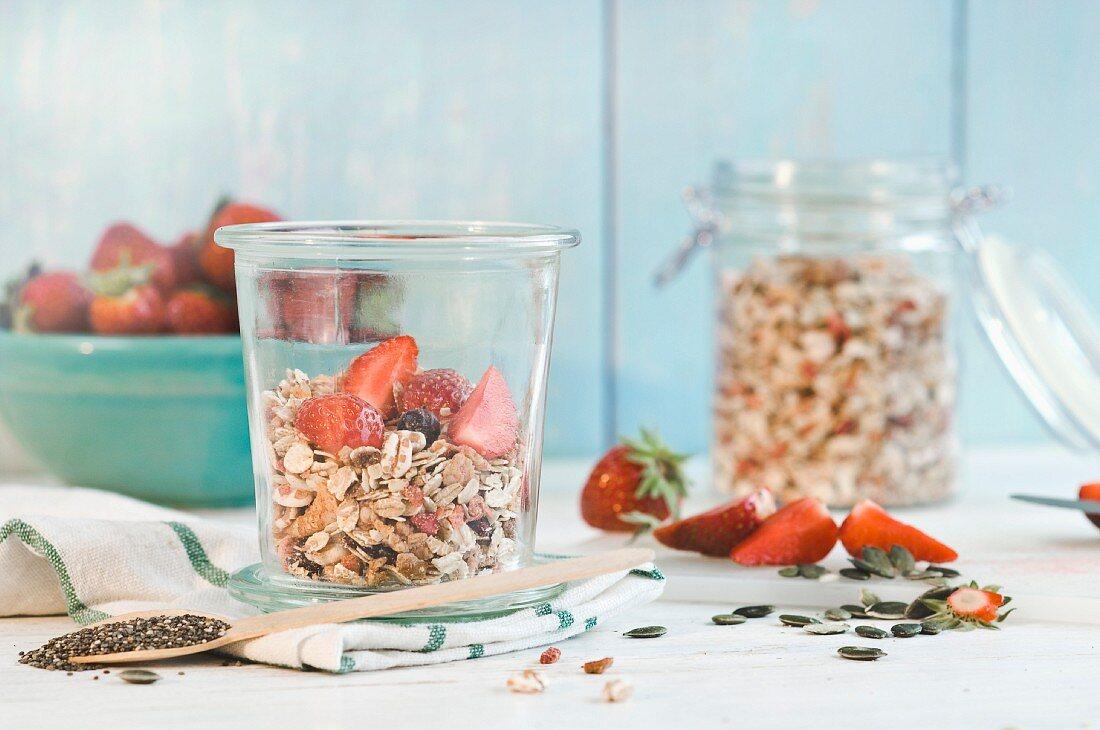 Muesli with fresh strawberries, pumpkin and chia seeds