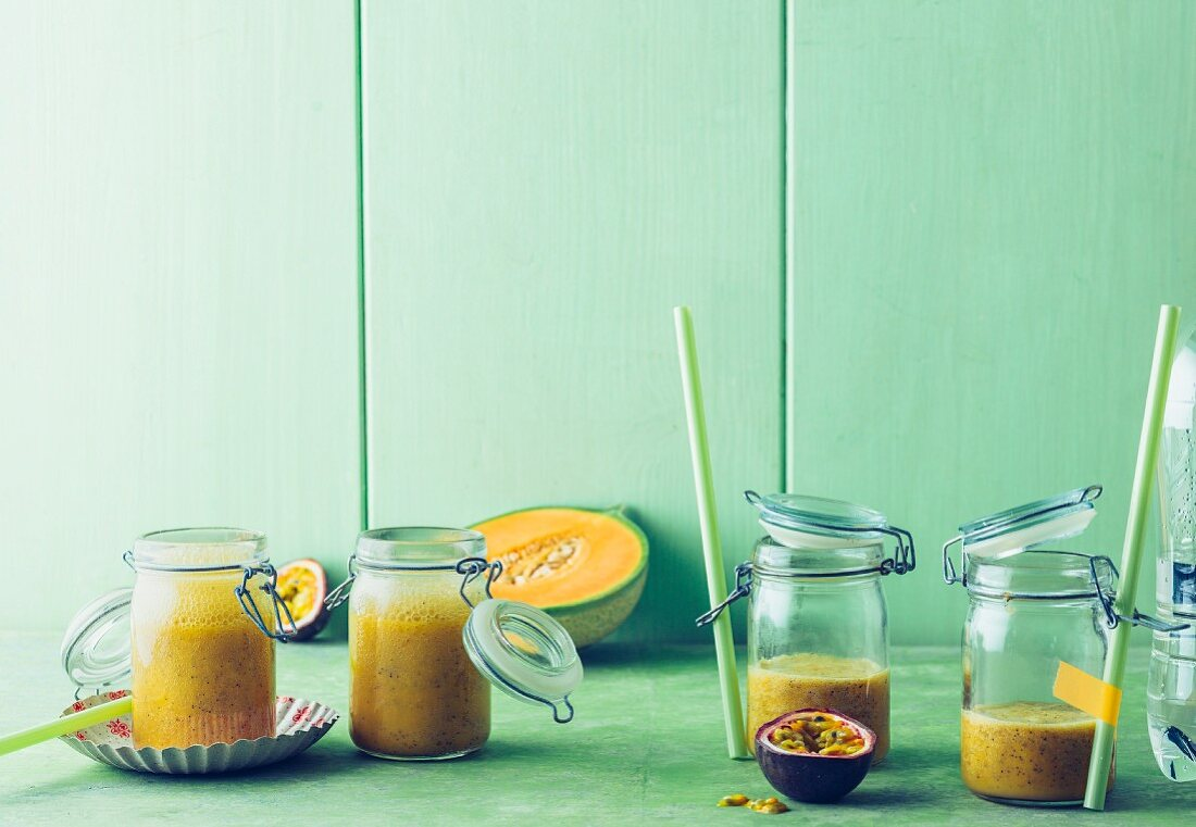 Flavoured 'agua fresca' with melon, passion fruit and pomegranate syrup