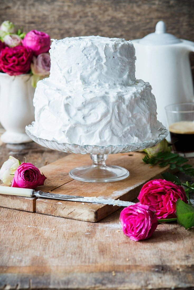 A rose water layer cake covered with meringue