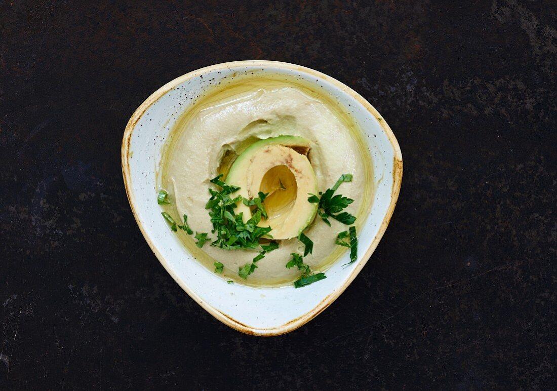 Avocado hummus in a bowl (Lebanon)
